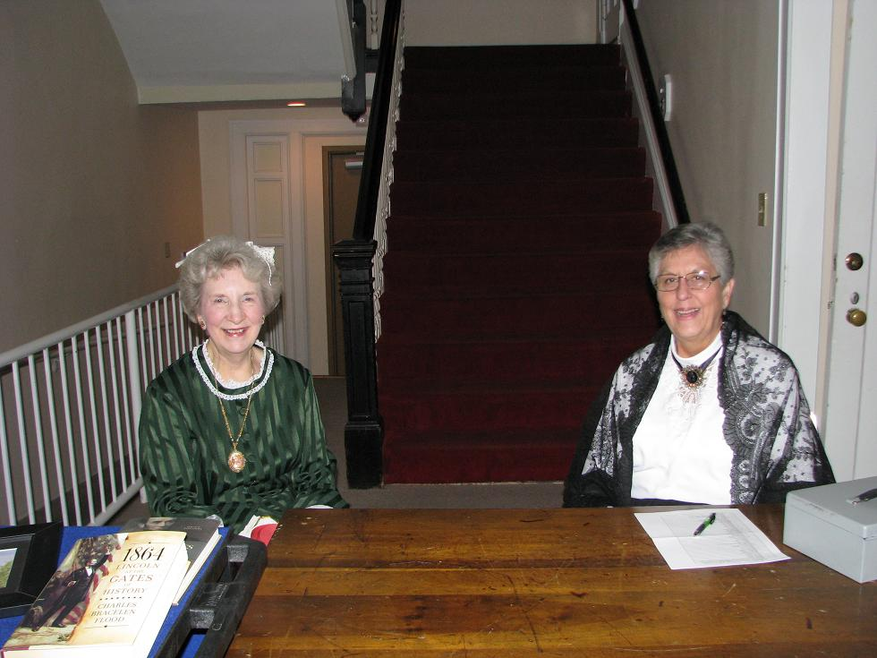 Civil War Ball - Delores Troup and Sharon Hachtel Sitting at a Desk